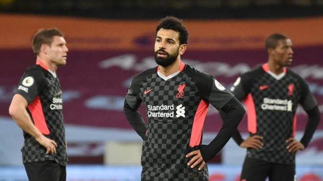 Liverpool's Mohamed Salah and teammates look dejected after conceding their seventh goal.(Pool via REUTERS)