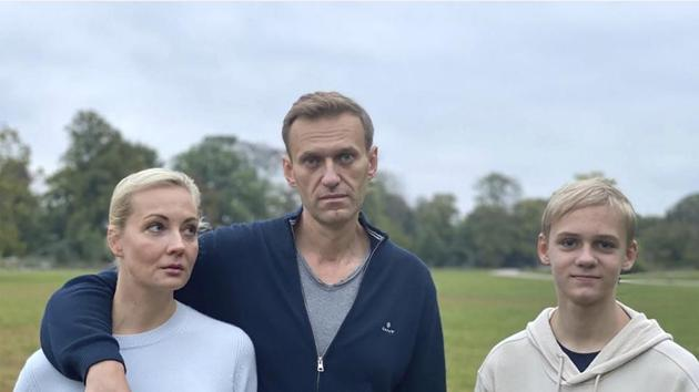 In this photo posted on the Instagram account of Russian opposition leader Alexei Navalny on Tuesday, Oct. 6, 2020, Navalny, center, poses for a photo with his wife Yulia and their son Zahar in an unknown location in Germany.(AP)