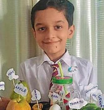 A student of Shivalik Public School in Mohali, with a tray full of his favourite healthy food items.(HT)