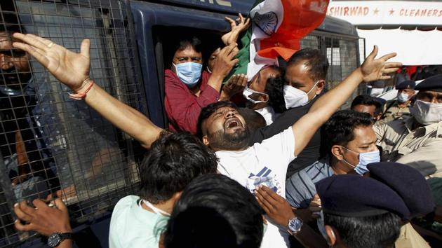 Supporters of Congress party react as they are detained by police during a protest over the Hathras alleged gang-rape case, in Ahmedabad, Wednesday, Oct. 7, 2020.(PTI photo)