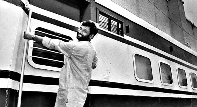 The then minister for railways, Ram Vilas Paswan, hangs outside a coach at the inauguration of the Railway Pavilion at Pragati Maidan on June 4, 1997.(HT Archive)