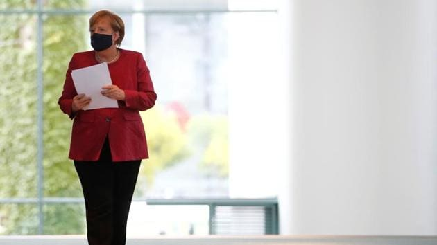 German Chancellor Angela Merkel arrives for a media statement after a video conference with mayors of German cities on the spread of the coronavirus disease (COVID-19), in Berlin, Germany.(REUTERS)