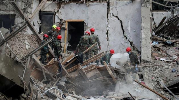Search and rescue teams work on the blast site hit by a rocket during the fighting over the breakaway region of Nagorno-Karabakh in the city of Ganja, Azerbaijan October 11, 2020.(Reuters photo)