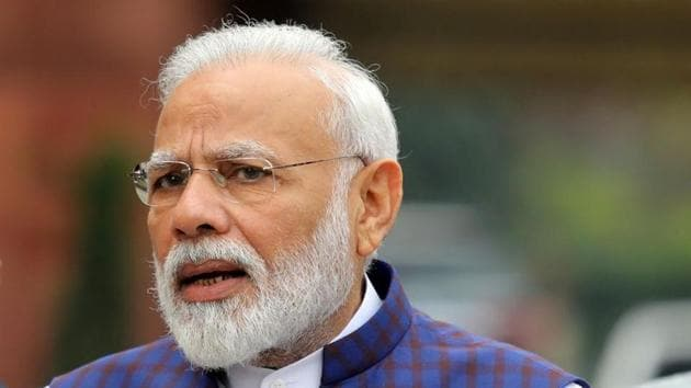 PM Modi will interact with some of the beneficiaries of the scheme as part of the event in which cards will be handed over to around 132,000 landowners.(Reuters image)