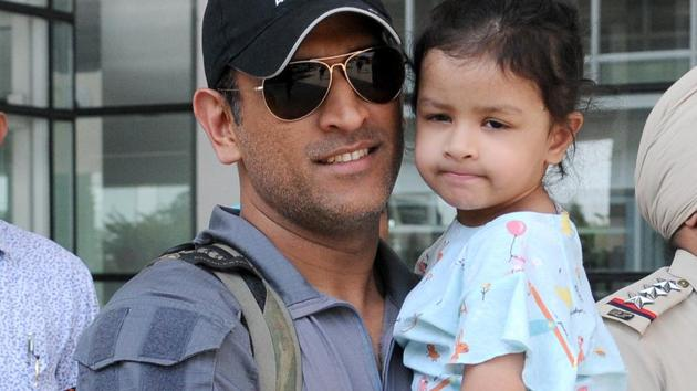 MS Dhoni of with his daughter at the Chandigarh airport in April 2018.(Ravi Kumar/HT File Photo)