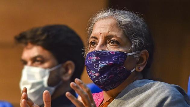 Union finance minister Nirmala Sitharaman (R) addresses a press conference in New Delhi.(PTI Photo)