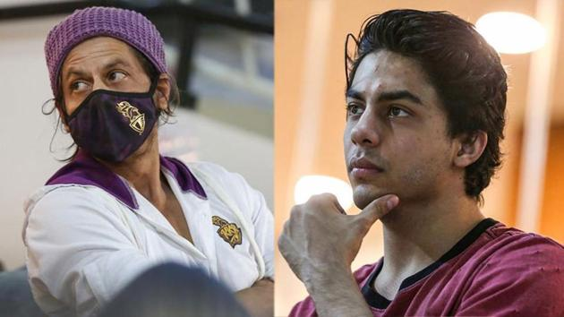 Shah Rukh Khan and son Aryan at Sharjah Cricket Stadium on Monday.(PTI)