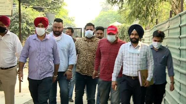 Gangster Baljit Chaudhary (fourth from right), being taken to court in Mohali.