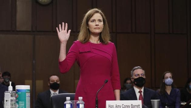 Amy Coney Barrett, US President Donald Trump's nominee for associate justice of the US Supreme Court, swears in to a Senate Judiciary Committee confirmation hearing in Washington, DC.(Bloomberg)