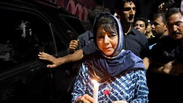 Former chief minister of Jammu and Kashmir and PDP leader Mehbooba Mufti during a candle march protest in Srinagar in August last year. (ANI Photo)