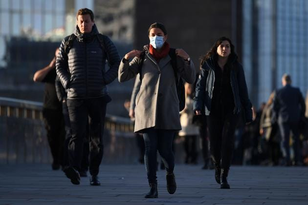 Commuters walk over London Bridge toward the City of London during morning rush hour(AFP)