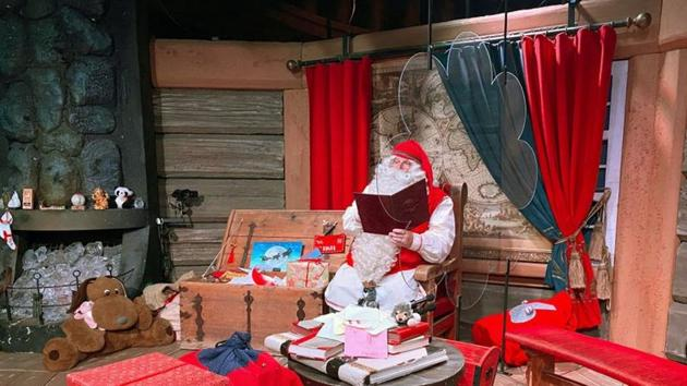 Santa Claus is pictured in his chamber behind a plexiglas screen at Santa Claus Village in the Arctic Circle near Rovaniemi, Finland.(REUTERS)