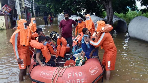 National disaster response force (NDRF) rescuing families near Hyderabad on Thursday.(ANI)