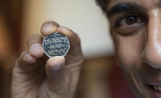 Image of chancellor Rishi Sunak holding the new 50 pence coin.(HM Treasury)