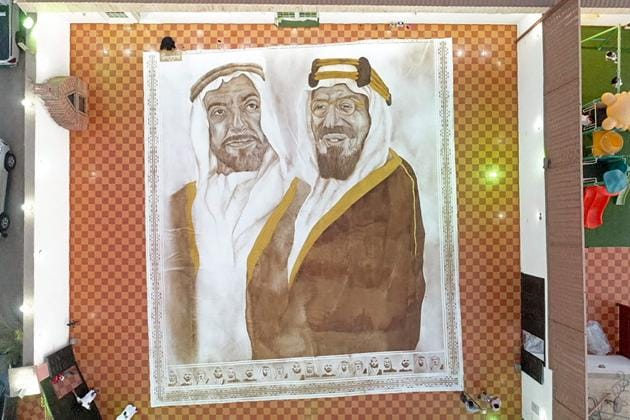 A handout picture released by the Guinness World Records on October 18, 2020 shows the world's largest coffee painting by Saudi artist Ohud Abdullah Almalki depicting founding fathers of Saudi Arabia and the UAE, the late King Abdulaziz bin Abdul Rahman (R) and the late Sheikh Zayed bin Sultan Al Nahyan, in Jeddah (Photo by - / Guinness World Records / AFP