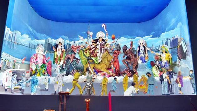 A Durga Puja pandal with paintings on coronavirus and Covid-19 treatment centre, in Kolkata on Monday.(ANI)