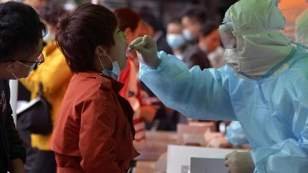 In picture - A medical staff takes a swab from a woman at Qingdao. Representational image.(AP)