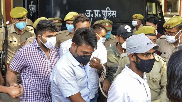 Police produce journalist Siddique Kappan and three others, suspected to have links with the Popular Front of India. (PTI Photo)(PTI)