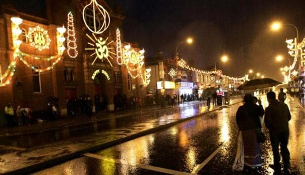 A file picture showing people milling around Leicester city centre looking at the festive lights of Diwali.(AFP file)