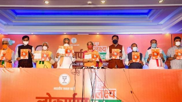 Union Finance Minister Nirmala Sitharaman along with BJP General Secretary Bhupendra Yadav (4th L) and state party President Sanjay Jaiswal (4th R) and others releases party manifesto ahead of the Bihar Assembly Elections, in Patna.(PTI)