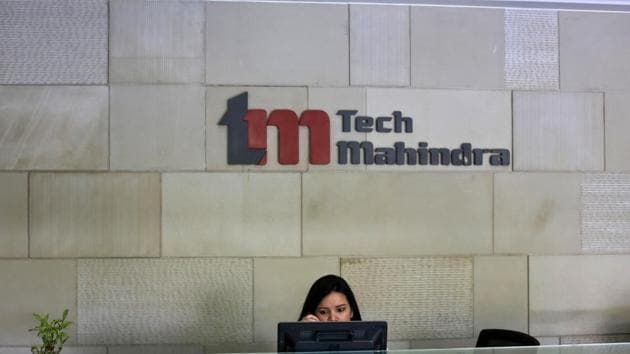An employee sits at the front desk inside Tech Mahindra's office in Noida in this file photo.(Reuters Photo)