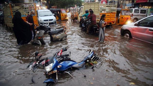 Motorists make their way on a flooded street following heavy rainfall, in Chennai on Thursday.(ANI)