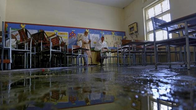 In picture - A classroom at Islamabad Model College for Girls in Islamabad is being sanitized for reopening. Representational image.(AP)