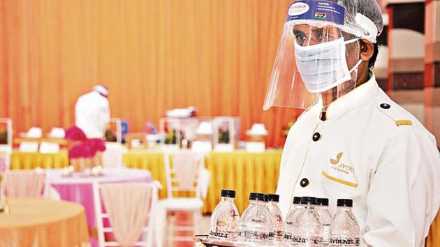 A server in PPE gear. Celebrations are making a comeback and bookings are trickling in, but weddings will continue to look different well into 2021.(Photo courtesy Megha Israni)