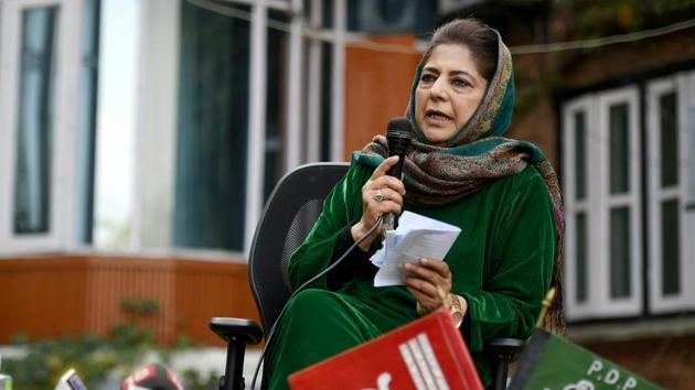 Flanked by three senior party leaders, the PDP president placed the party flag and the flag of the former state on a table in front of her.(PTI)