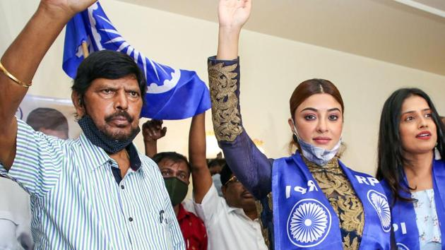 Actress Payal Ghosh with Union Minister and RPI chief Ramdas Athawale at a press conference after she joined the Republican Party of India (RPI) as vice president of its women's wing, in Mumbai, Monday, October 26, 2020.(PTI photo)