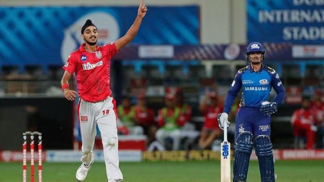 Kings XI Punjab bowler Arshdeep Singh celebrates the wicket of Mumbai Indians (MI) captain Rohit Sharma during their Indian Premier League (IPL) T20 cricket match.(PTI)