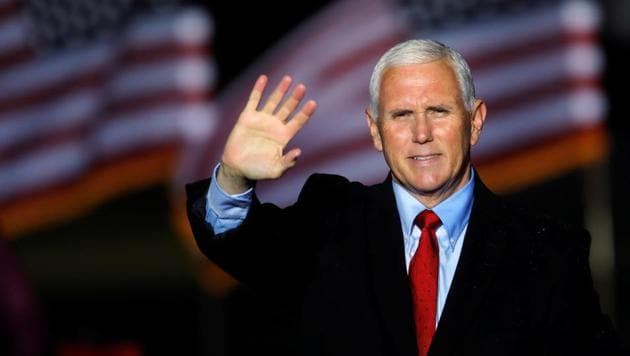 US Vice President Mike Pence waves to supporters at the end of a rally in Kinston, North Carolina.(REUTERS)