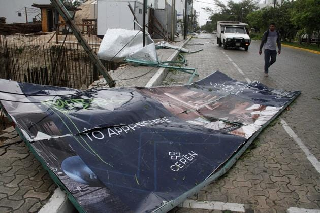 A billboard lays on the ground, toppled by Hurricane Zeta in Playa del Carmen, Mexico. Zeta is leaving Mexico's Yucatan Peninsula on a path that could hit New Orleans Wednesday night. (AP Photo/Tomas Stargardter)
