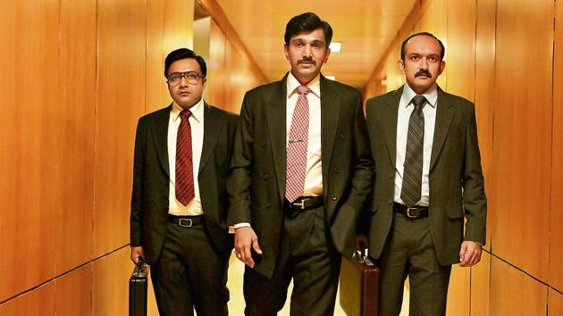 Pratik Gandhi (at centre) as the stockbroker Harshad Mehta in the web series Scam 1992, directed by Hansal Mehta. The series is based on Sucheta and Debashis Basu's book,The Scam: Who Won, Who lost, Who Got Away.(Photo: Sony Liv)