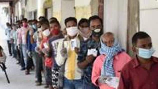 People stand in a queue to cast their votes during the first phase of Bihar assembly polls.(PTI)