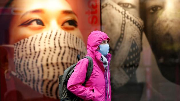 A pedestrian walks past a Primark clothes store in Nottingham, central England on October 29. The United Kingdom has crossed 1 million coronavirus cases as England, the largest constituent of the UK, prepares for a second complete lockdown in an attempt to curb the rapid spread of Covid-19 infections. (Darren Staples / AFP)