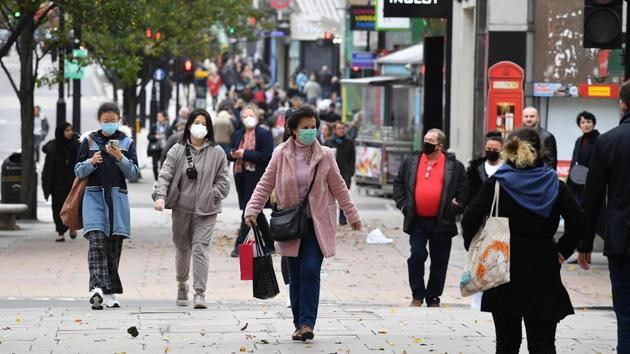 "Pedestrians walk in central London on November 1 as England prepares to enter a second lockdown. As the experts ran through the latest figures and statistics showing a surge in the numbers being infected by the coronavirus, Prime Minister Johnson declared that ""no responsible PM can ignore the message of those figures."" (Justin Tallis / AFP)"