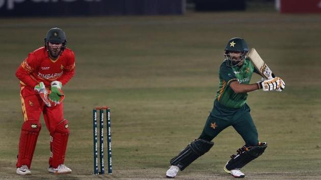 Rawalpindi:Pakistani batsman Babar Azam, right, plays a shot while Zimbabwe's wicketkeeper Brendan Taylor, watches during their 2nd one-day international cricket match at the Pindi Cricket Stadium, in Rawalpindi, Pakistan, Sunday, Nov. 1, 2020. AP/PTI Photo)(AP01-11-2020_000191A)(AP)