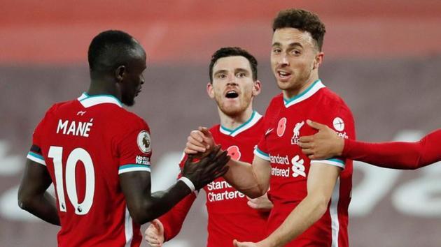 Liverpool's Diogo Jota celebrates scoring their second goal with teammates.(Pool via REUTERS)