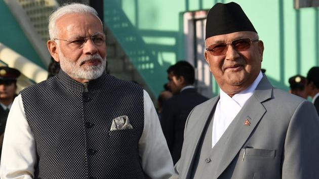 Nepali Prime Minister K.P Sharma Oli greets Indian Prime Minister Narendra Modi during a guard of honour in Kathmandu on May 11, 2018.(AFP)