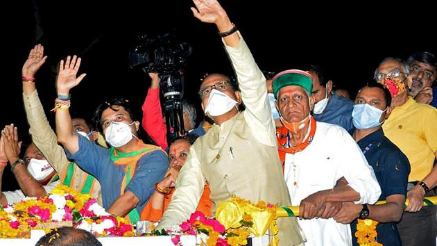 Madhya Pradesh Chief Minister Shivraj Singh Chouhan along with BJP MP Jyotiraditya Scindia during a roadshow for by-polls in Gwalior on Friday.(ANI)