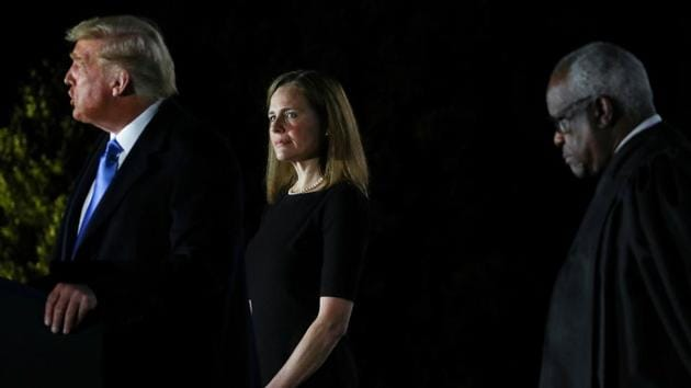 Judge Amy Coney Barrett being sworn in to serve as an associate justice of the US Supreme Court by Justice Clarence Thomas on the South Lawn of the White House.(REUTERS)
