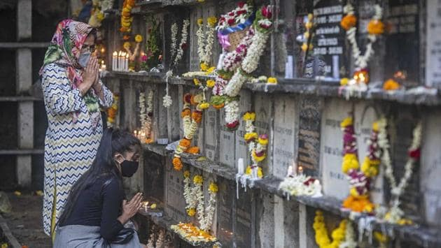 People visit City Church Cemetery as they observe All Souls' Day to commemorate and to pray for the departed loved ones in Pune on November 2. So far, 123,097 people have succumbed to the virus with 496 deaths in the past 24 hours. (Pratham Gokhale / HT Photo)