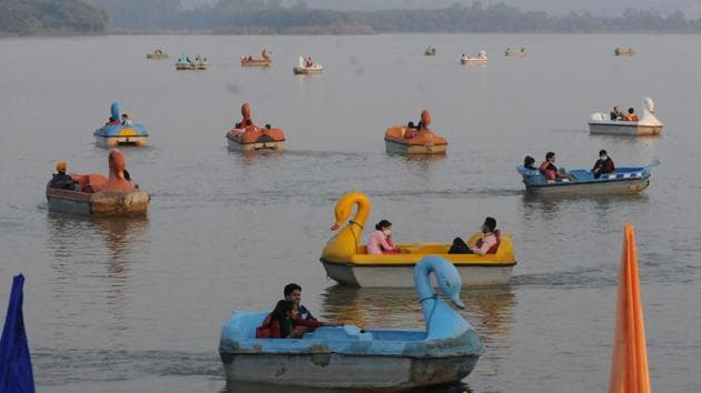 People enjoy boat rides at Sukhna Lake in Chandigarh on November 1. According to the Union Health Ministry, such spikes in cases are a result of the increased activity due to the festive season as well as violations of basic codes of Covid-19 appropriate behaviour in public. (Keshav Singh / HT Photo)
