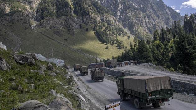An Indian army convoy moves on the Srinagar- Ladakh highway.(AP Photo)