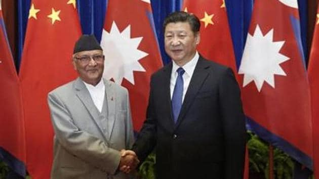 A file photo of Chinese President Xi Jinping (right) with Nepalese Prime Minister KP Sharma Oli .(AFP file)