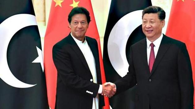China's President Xi Jinping shakes hands with Pakistan's Prime Minister Imran Khan.(AFP File Photo)