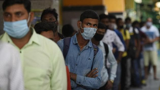 Passengers wearing face masks wait their turn to give samples for coronavirus test after arriving at Hazrat Nizamuddin Railway Station in New Delhi on October 30. The report also mentioned that in a span of just two months, the percentage of active cases has reduced more than 3 times. On 3rd September, the percentage of active cases was 21.16%. (Biplov Bhuyan / HT Photo)