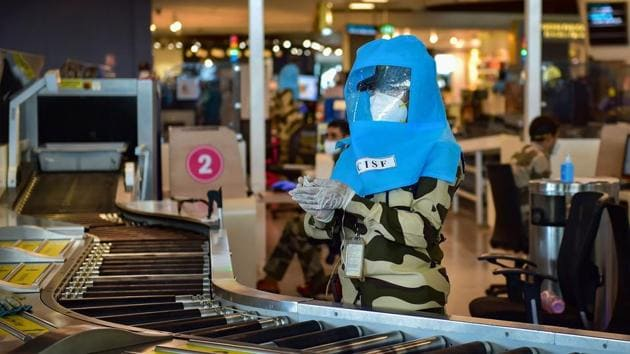 A CISF personnel stands guard at a security screening counter inside Kempegowda International airport.(File photo)