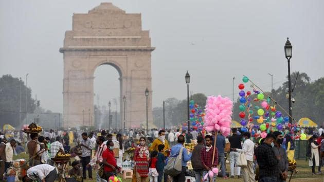 People at Rajpath amid the coronavirus pandemic in New Delhi on November 1. India continues to be the second worst coronavirus-hit country in the world after the United States but it also has the highest number of recovered cases globally. (Ravi Choudhary / PTI)